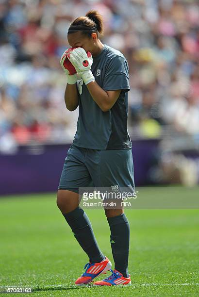 Sarah Bouhaddi of France reacts during the Olympic womens bronze medal match between Canada and France on day 13 of the London 2012 Olympic Games at...