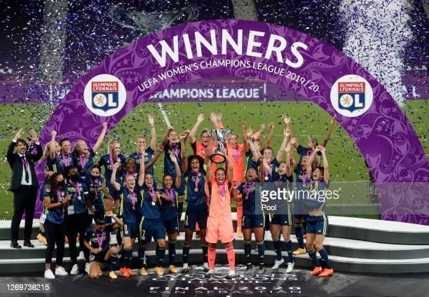 Sarah Bouhaddi of Olympique Lyon lifts the UEFA Women's Champions League Trophy following her team's victory in the UEFA Women's Champions League...