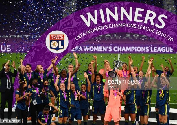 Sarah Bouhaddi of Olympique Lyon lifts the UEFA Women's Champions League Trophy following her team's victory in the UEFA Women's Champions League...