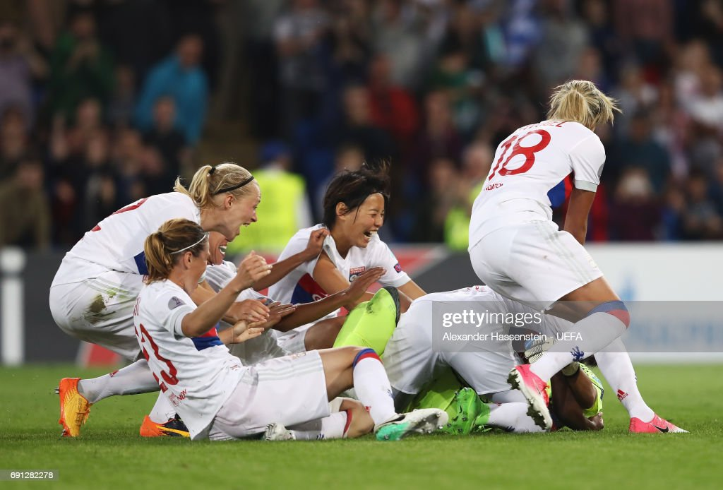 Sarah Bouhaddi of Olympique Lyonnais (obscured) celebrates victory with team mates as she scores the winning penalty in the shoot out during the UEFA Women's Champions League Final between Lyon and Paris Saint Germain at Cardiff City Stadium on June 1, 2017 in Cardiff, Wales. Olympique Lyonnais win 7-6 on penalties after the match finished 0-0.