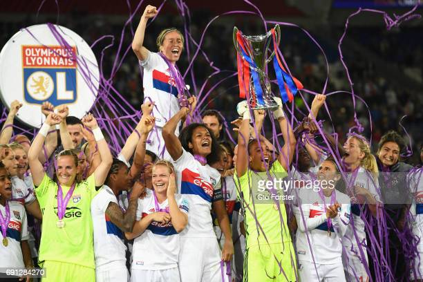 Sarah Bouhaddi of Olympique Lyonnais lifts the trophy in victory after the UEFA Women's Champions League Final between Lyon and Paris Saint Germain...