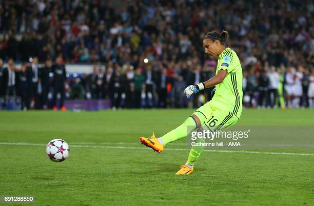 Sarah Bouhaddi of Olympique Lyonnais scores her penalty to win the match during the UEFA Women's Champions League Final match between Lyon and Paris...