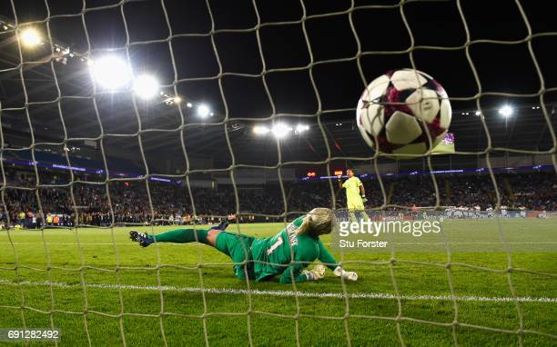 Sarah Bouhaddi of Olympique Lyonnais scores the winning penalty in the shoot out past goalkeeper Katarzyna Kiedrzynek of Paris SaintGermain Feminines...