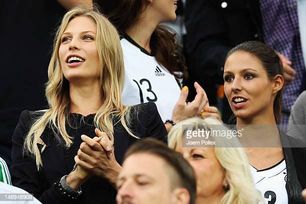 Sarah Brandner girlfriend of Bastian Schweinsteiger and Silvia Meichel girlfriend of Mario Gomez look on during the UEFA EURO 2012 quarter final...