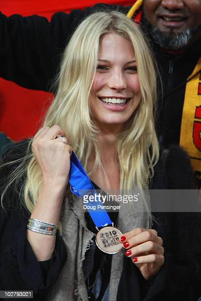 Sarah Brandner girlfriend of Bastian Schweinsteiger of Germany poses with a medal following the 2010 FIFA World Cup South Africa Third Place Playoff...