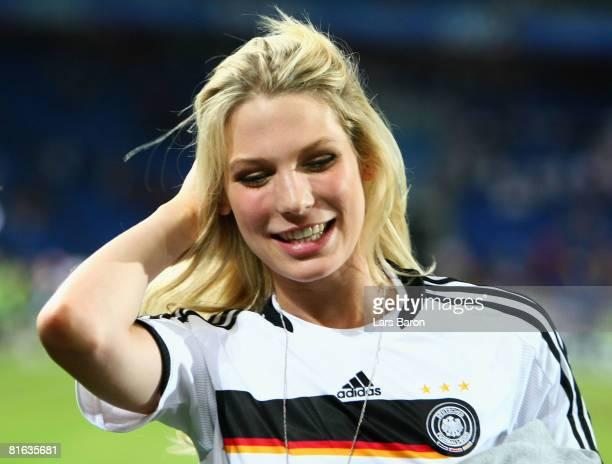 Sarah Brandner, girlfriend of Bastian Schweinsteiger smiles after Germany defeated Portugal during the UEFA EURO 2008 Quarter Final match between...