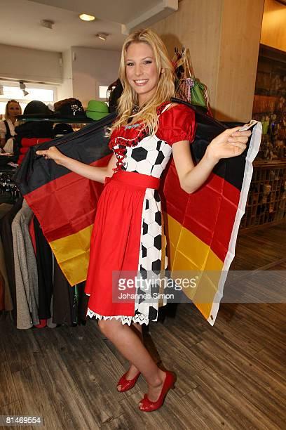 Sarah Brandner girlfriend of German national player Bastian Schweinsteiger presents the football eurodirndl at Trachtenmoden Angermaier on June 6...
