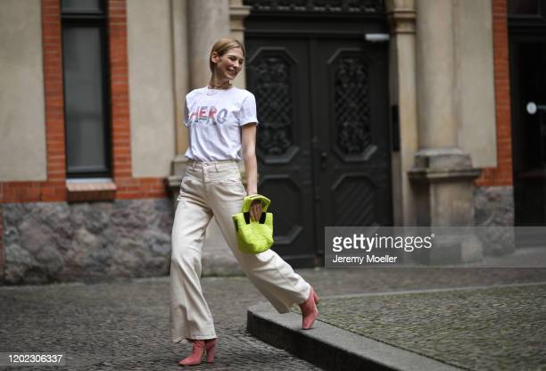 Sarah Brandner wearing Closed jeans, Jimmy Choo boots, Vee Collective bag and Katja Eichinger shirt on January 26, 2020 in Berlin, Germany.