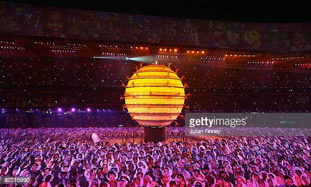Sarah Brightman and Liu Huan sing on top of a large globe during the Opening Ceremony for the 2008 Beijing Summer Olympics at the National Stadium on...