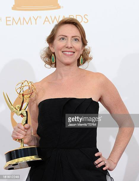 Sarah Bromell who accepted on behalf of her husband Writer Henry Bromell winner of the Best Writing for a Drama Series Award for Homeland poses in...