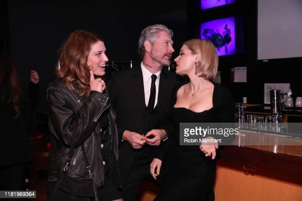 Sarah Brooks Travis Stevens and Sarah Lind attend the red carpet premiere of Girl On The Third Floor at the Chicago International Film Festival on...