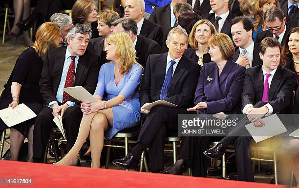 Sarah Brown talks with someone behind her as her husband former British prime minister Gordon Brown speaks with the wife of the Speaker of the House...