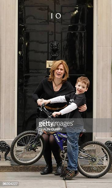Sarah Brown wife of British Prime Minister Gordon Brown poses with sevenyearold Charlie Simpson outside 10 Downing Street in central London on...