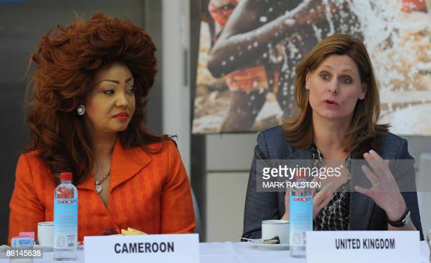 Sarah Brown wife of the British Prime Minister Gordon Brown is watched by First Lady Chantal Biya of Cameroon during the African First Ladies Health...