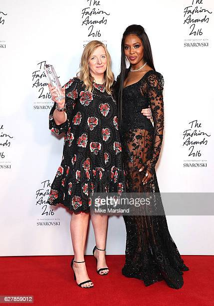Sarah Burton accepting the British Brand award on behalf of McQueen with Naomi Campbell at The Fashion Awards 2016 at Royal Albert Hall on December 5...