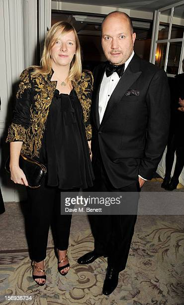 Sarah Burton and David Burton attend a drinks reception at the 58th London Evening Standard Theatre Awards in association with Burberry at The Savoy...