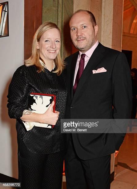 Sarah Burton and David Burton attend the Harper's Bazaar Women Of The Year awards 2014 at Claridge's Hotel on November 4 2014 in London England