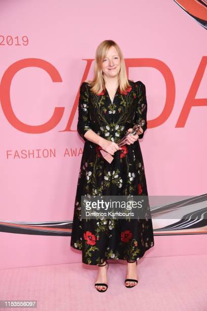 Sarah Burton poses with the Valentino Garavani and Giancarlo Giammetti International Award during Winners Walk during the CFDA Fashion Awards at the...