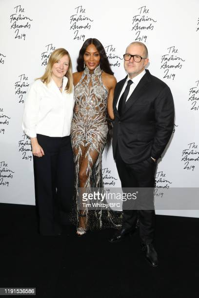 Sarah Burton, winner of the Trailblazer award, Naomi Campbell, winner of the Fashion Icon award, and Sir Jony Ive pose in the winners room during The...