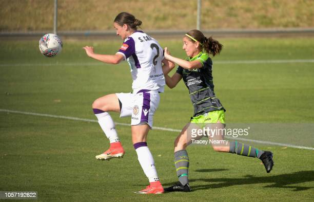 Sarah Carroll of Perth Glory is tackled by Karly Roestbakken of Canberra United during the round two WLeague match between Canberra United and the...