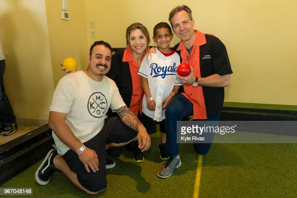 Sarah Chalke and Jake Tapper pose for a photo with a patient and family member from Children's Mercy Hospital while participating in bocce ball at...