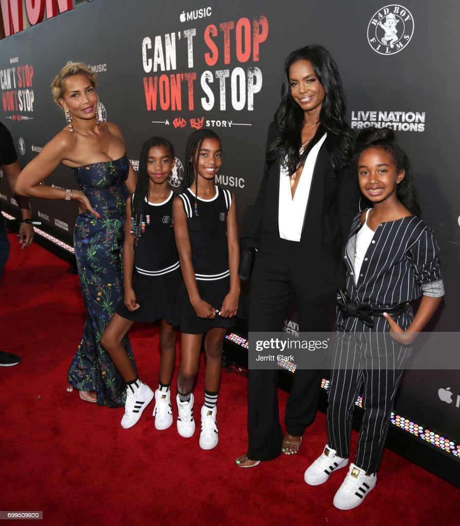 Sarah Chapman and Kim Porter poses with daughters DLila