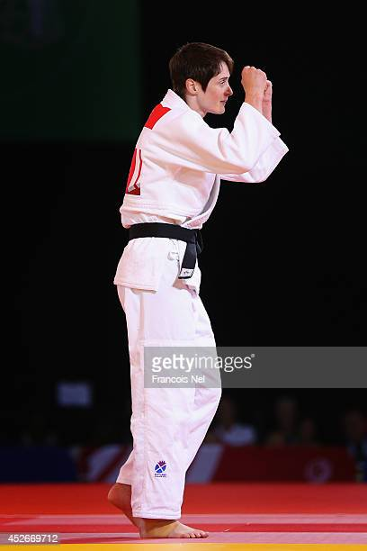 Sarah Clark of Scotland celebrates winning gold in the Women's 63kg gold Medal Contest at SECC Precinct during day two of the Glasgow 2014...