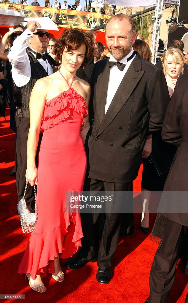 Sarah Clarke and Xander Berkeley during The 55th Annual Primetime Emmy Awards - Access Hollywood Red Carpet at The Shrine Theater in Los Angeles, California, United States.