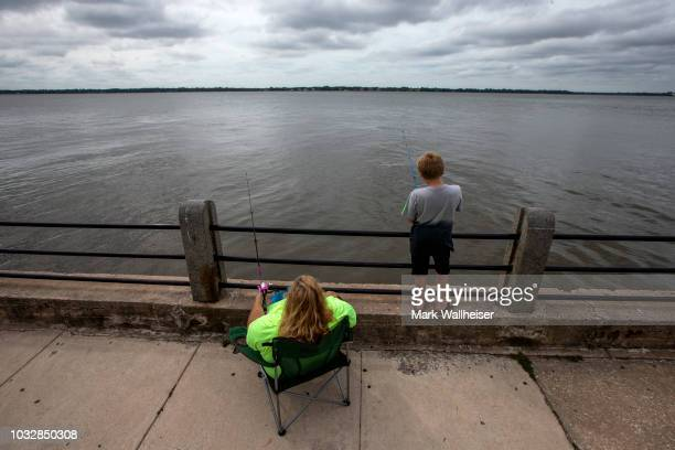 Sarah Connor and her son AJ 13 years old fish in Charleston Harbor as they await the arrival of Hurricane Florence on September 13 2018 in Charleston...