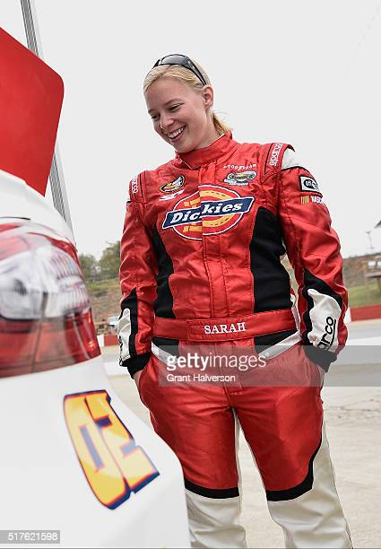 Sarah CornettChing driver of the Dickies Toyota smiles as she looks at a dent on the back quarter panel of her race car during the NASCAR KN Pro...