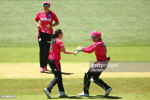 Sarah Coyte and Alyssa Healy of the Sixers celebrate the wicket of Heather Graham of the Scorchers during the Women's Big Bash League final match...