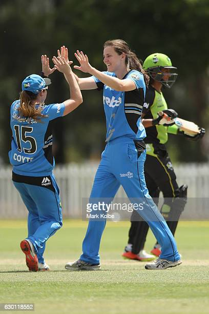 Sarah Coyte and Tahlia McGrath of the Strikers celebrate McGrath taking the wicket of Claire Koski of the Thunder during the WBBL match between the...