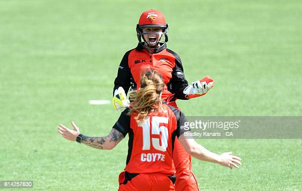 Sarah Coyte and Tegan McPharlin of South Australia celebrate taking the wicket of Nicola Carey of NSW during the WNCL match between New South Wales...