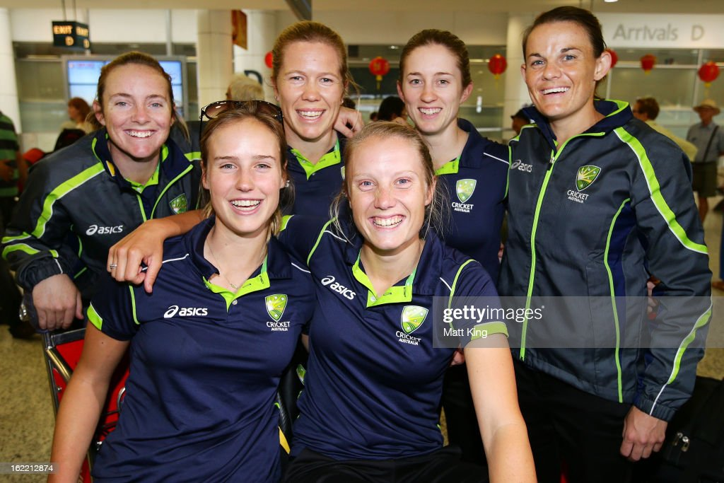 Sarah Coyte, Ellyse Perry, Alex Blackwell, Alyssa Healy, Rachael Haynes and Erin Osborne of the Australian women's cricket team pose after arriving home following their win in the 2013 World Cup at Sydney International Airport on February 21, 2013 in Sydney, Australia.