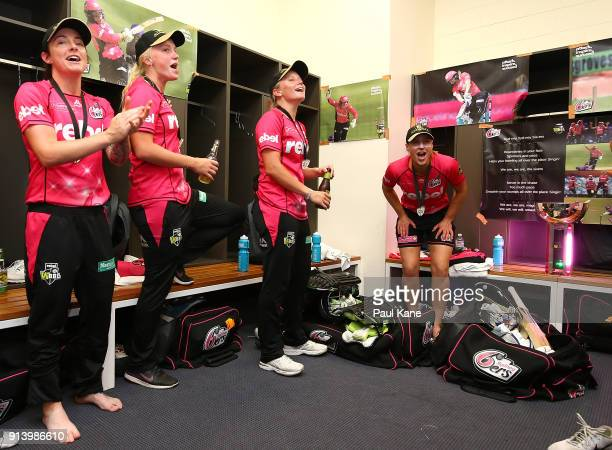 Sarah Coyte Kim Garth Alyssa Healy and Ellyse Perry of the Sixers sing the team song after winning the Women's Big Bash League final match between...