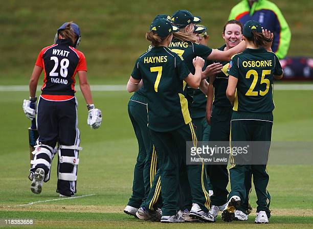 Sarah Coyte of Australia is congratulated by team mates after bowling Danielle Wyatt of England during the NatWest Women's Quadrangular Series Final...