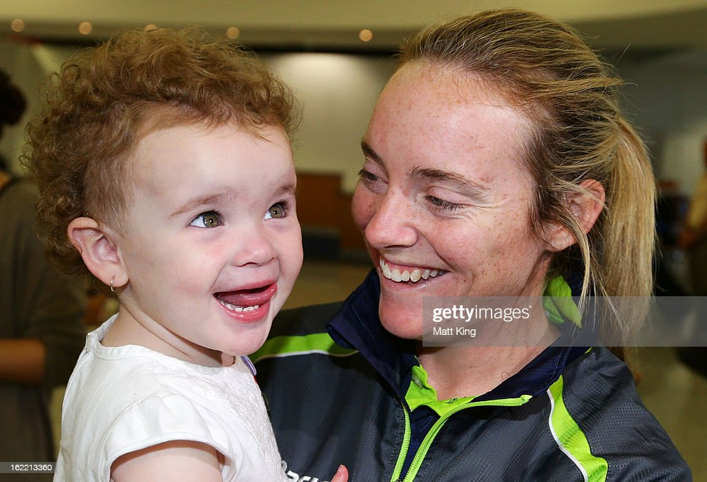 Sarah Coyte of the Australian women's cricket team shares a moment with her niece Amahni after arriving home following their win in the 2013 World Cup at Sydney International Airport on February 21, 2013 in Sydney, Australia.