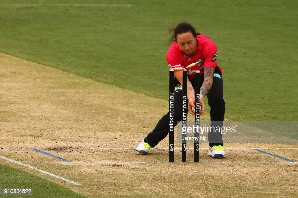 Sarah Coyte of the Sixers attempts a run out during the Women's Big Bash League match between the Adelaide Strikers and the Sydney Sixers at...