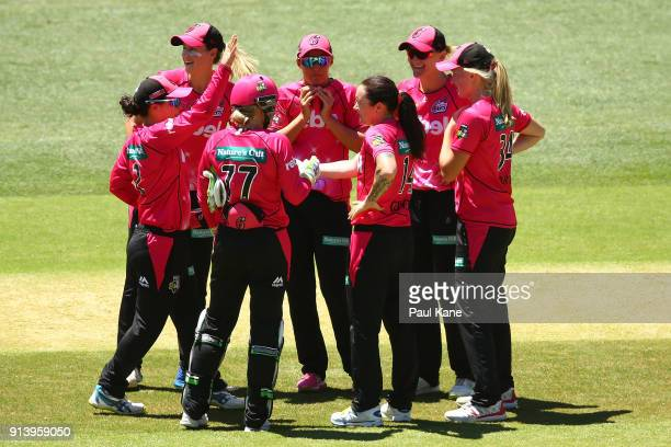 Sarah Coyte of the Sixers celebrates the wicket of Heather Graham of the Scorchers during the Women's Big Bash League final match between the Sydney...