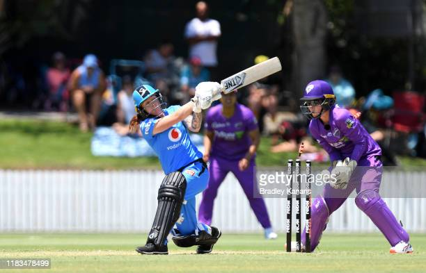 Sarah Coyte of the Strikers is bowled by Nicola Carey of the Hurricanes during the Women's Big Bash League match between the Adelaide Strikers and...