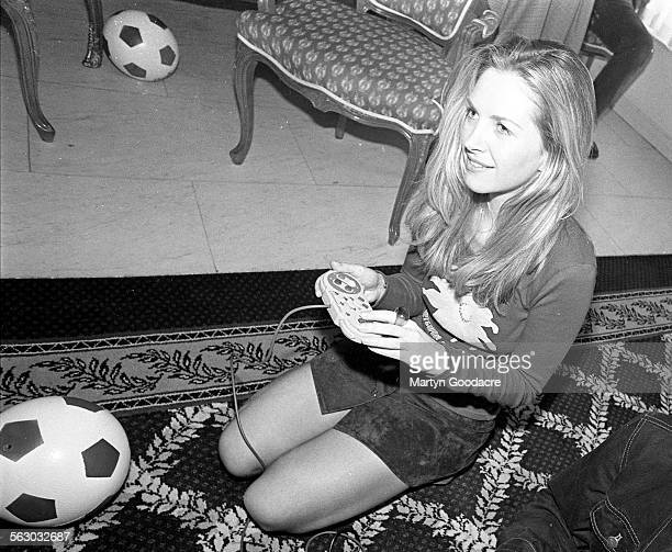 Sarah Cracknell of St Etienne playing on a Super Nintendo games console London United Kingdom 1994