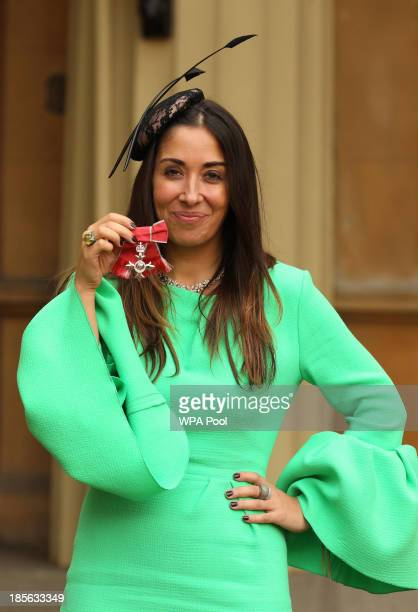 Sarah Curran Founder of MyWardrobecom holds her medal after being made a Member of the Order of the British Empire by the Prince of Wales during an...