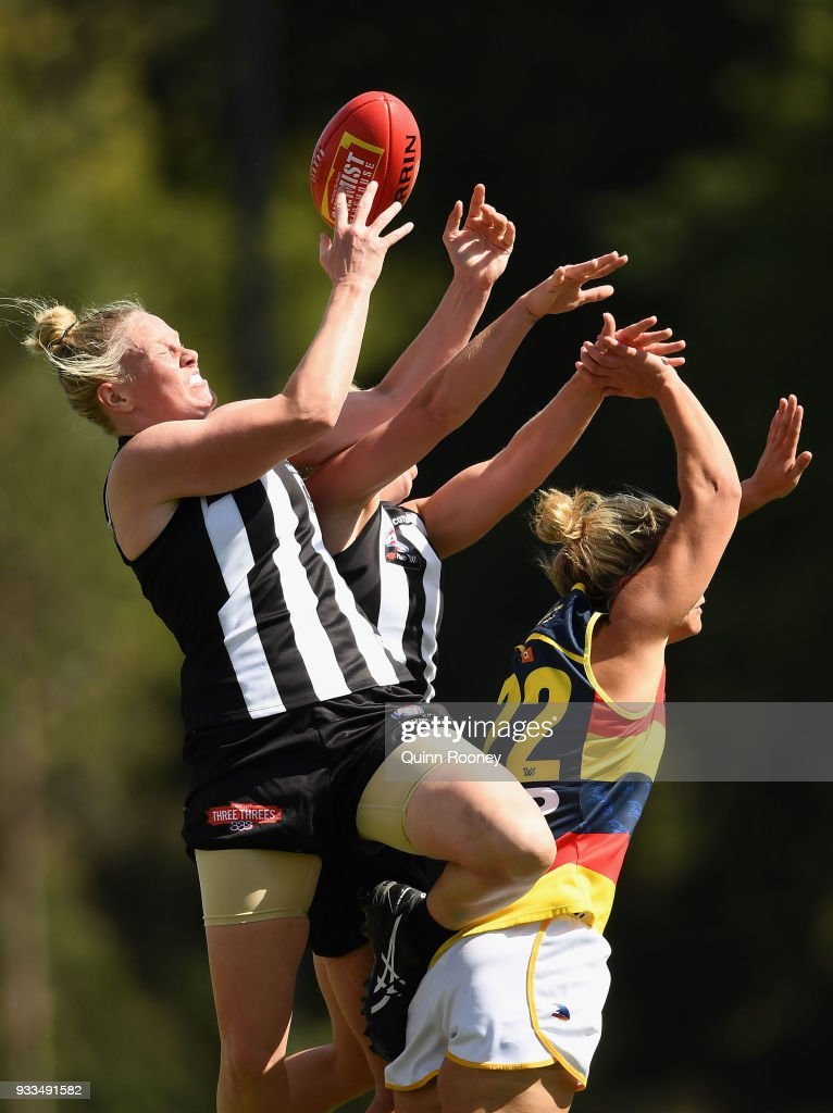 Sarah DÕArcy of the Magpies attempts to mark during the round seven AFLW match between the Collingwood Magpies and the Adelaide Crows at Olympic Park on March 18, 2018 in Melbourne, Australia.