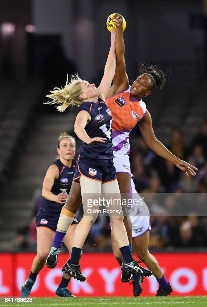 Sarah D'Arcy of Victoria and Sabrina FrederickTraub of the Allies compete in the ruck during the AFL Women's State of Origin match between Victoria...