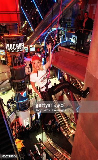 Sarah Donahue a dangerous sports performer James Bond stunt woman and television presenter launching the new James Bond store by abseiling into in...