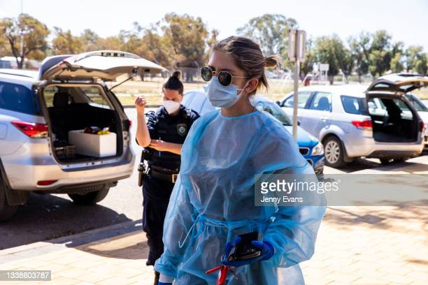 Sarah Donnelley helps to load cars with food and supplies on September 06, 2021 in Wilcannia, Australia. After hearing locals in isolation were...
