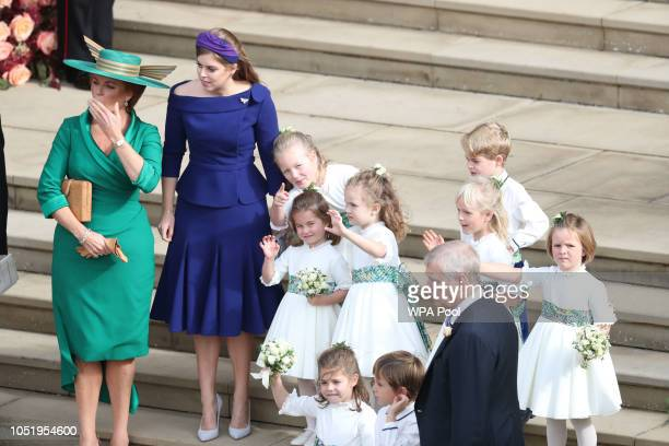Sarah Duchess of York and Princess Beatrice of York and the bridesmaids and page boys including Princess Charlotte and Prince George wave off...