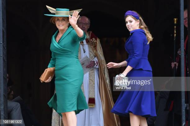 Sarah Duchess of York and Princess Beatrice of York arrive ahead of the wedding of Princess Eugenie of York and Mr Jack Brooksbank at St George's...