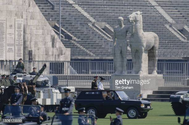 Sarah, Duchess of York attends a parade for the birthday of Queen Elizabeth II by the Olympiastadion in Berlin, Germany, 26th May 1989. A sculpture...
