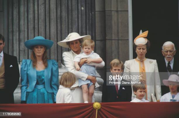 Sarah Duchess of York, Diana, Princess of Wales , Prince Harry and Princess Anne watch the Trooping the Colour ceremony from the balcony of...